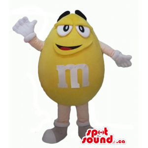 Happy yellow  M&M's  CandyMascot with white gloves and shoes